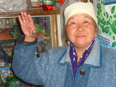 Kyrgyz Woman Saying Hello - Karakol, Kyrgyzstan