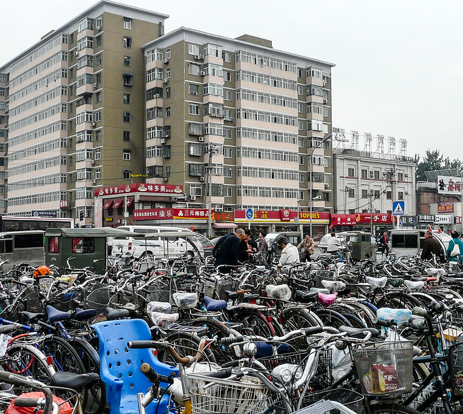 Hundreds of bicycles parked in front of a Beijing apartment building near The Temple of Heaven Park.