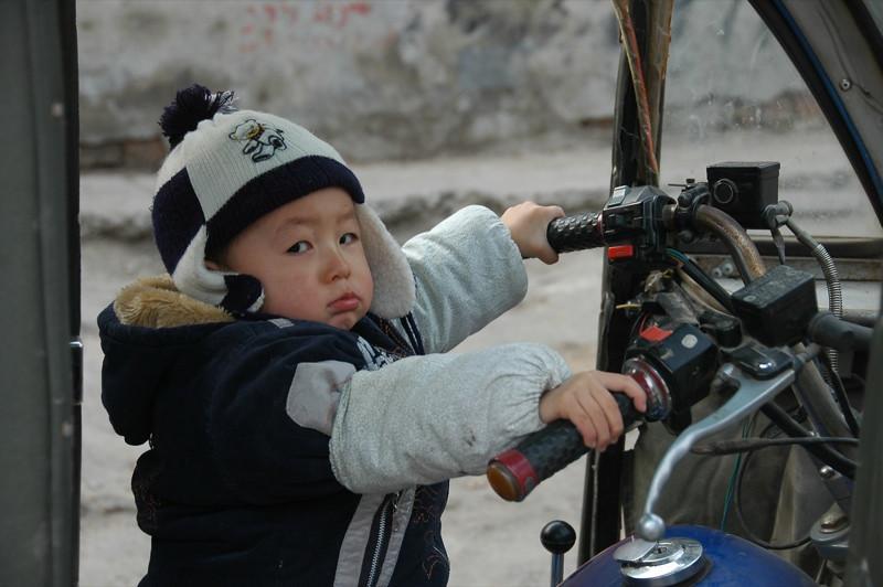 Chinese Boy on Motorbike - Beijing, China
