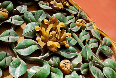 Detailed artwork on the walls of the Forbidden City in Beijing, China.