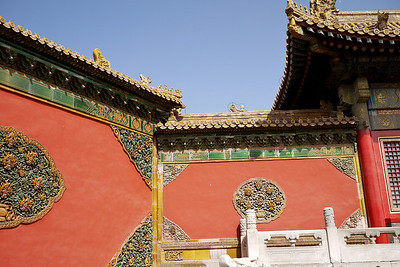 Green and yellow art decorations on the walls at the Forbidden City in Beijing, China.
