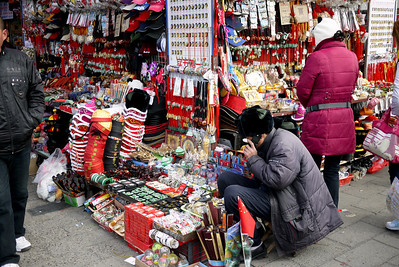 Vendors push knickknacks and souvenirs at the Forbidden City in Beijing, China.