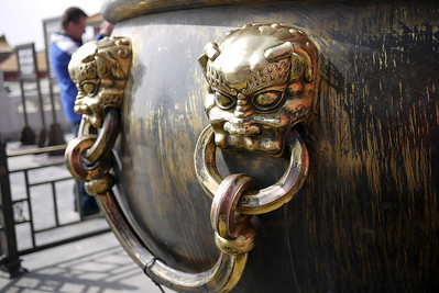 Elaborate and ornate decorations on the cisterns in the Forbidden City in Beijing, China.
