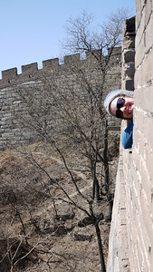 Niki poking out of the Great Wall of China