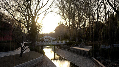 A gorgeous park at sunset just off the main street in Beijing, China.