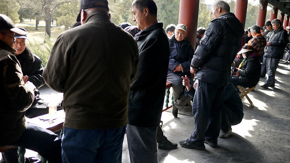 Locals congregate in the long hallway at the Temple of Heaven for card games and social time.