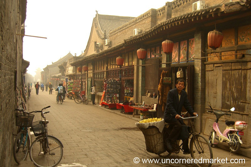 Man on a Bike Selling Apples - Pingyao, China