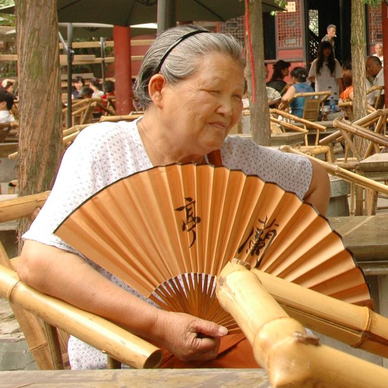 Chinese Woman with Fan - Chengdu, China