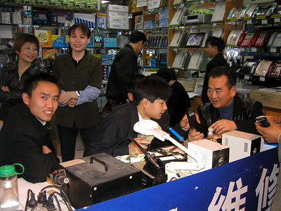 Chengdu Mobile phone market March 2002...  refurb anything here..
