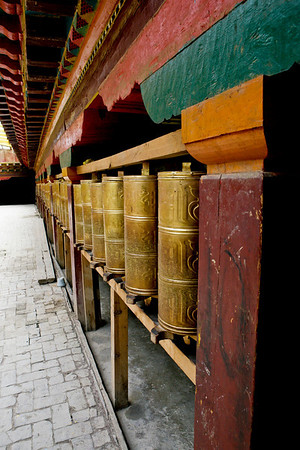 Prayer wheels at the Sumzanling Monastery