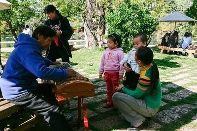 Children watching a musician