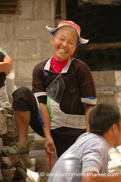 Gejia Woman Laughing - Guizhou Province, China