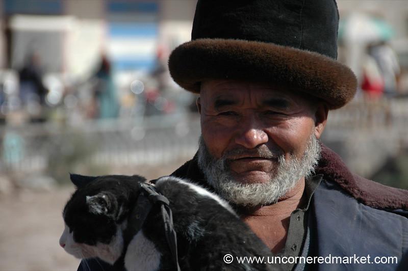 Uighur Man and His Cat - Kashgar, China