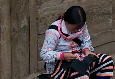 "Young woman working on embroidery in the ""Long Horn Miao"" village"