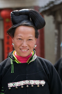 """Short Skirt Miao"" woman, wearing her hair traditionally."
