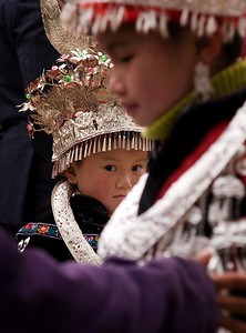 The Miao girls are dressed in the family's silver ornaments, the more the better.  It's a way of showing how prosperous the family is.