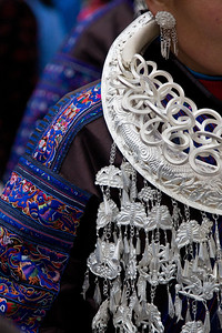 Detail of the beautifully embroidered jackets worn by the women.  Depending on the design/complexity, the embroidery can take over a year to complete.  Festival outfits in pristine condition can sell for thousands of USD.