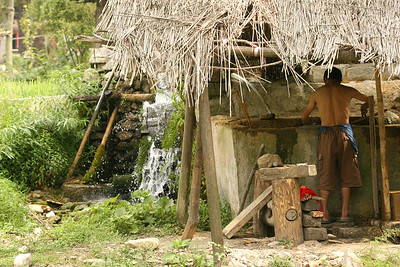 One step in the paper making process involves grinding up the bamboo fibers, using a mill stone powered by a water wheel.