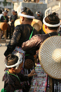 Another Basha boy waiting for the performance.  The Basha men still wear their hair in the traditional fashion.