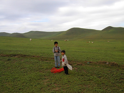 Inner Mongolia 2002, kids catching butterflies! A wonderfully peaceful and lovely area, great fun horseback riding too.