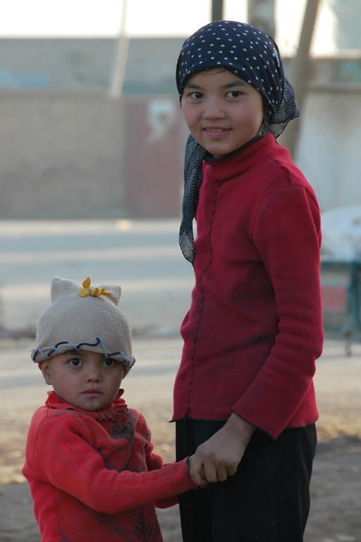 Kashgar Animal Market: Uighur Brother and Sister - China