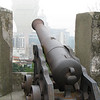 Macau's Monte Fort. This canon appears to take aim at the Grand Lisboa Casino through the mist.
