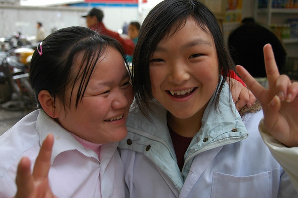 Chinese Girls with Peace Signs - Shanghai, China