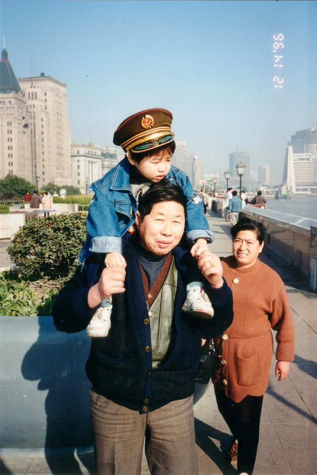 1996: Grand parents with son walking along the Shanghai Bund, Dec 1996