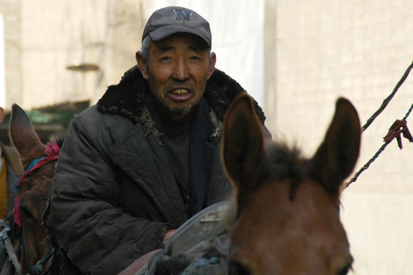 Chinese Man on a Horse - Pingyao, China