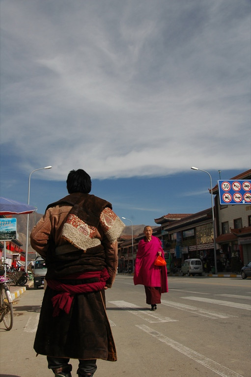Men Walking Down Street - Xiahe, China