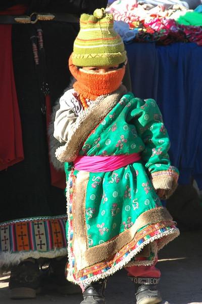 Tibetan Girl All Bundled Up - Xiahe, China
