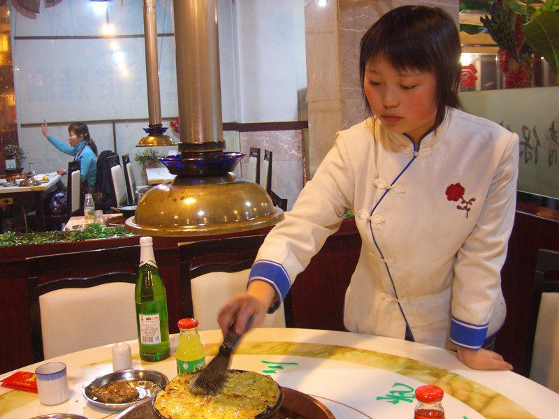 Waitress at Hot Pot Restaurant - Urumqi, China