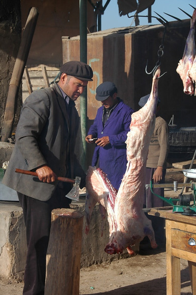 Kashgar Animal Market: Cutting Up Meat - China