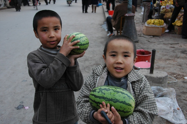 Uighur Boys Bringing Watermelons - Kashgar, China