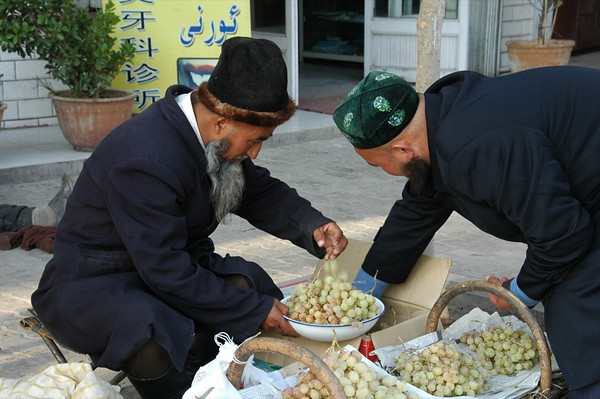 Kashgar Old Town, Selecting Grapes - Xinjiang, China