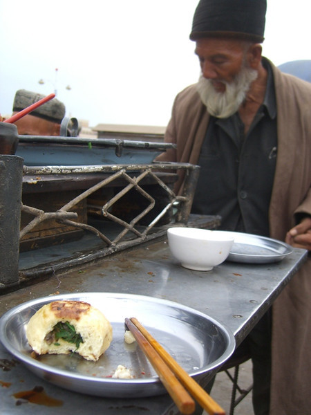 Old Man and Unfinished Dumplings - Kashgar, China