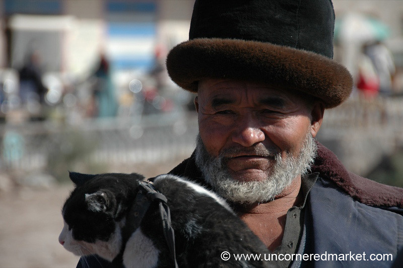 Uighur Man and His Cat - Kashgar, China