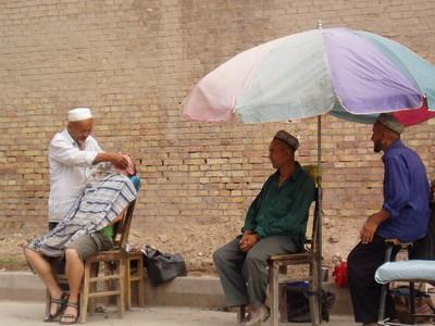 urghur street barber, kashgar