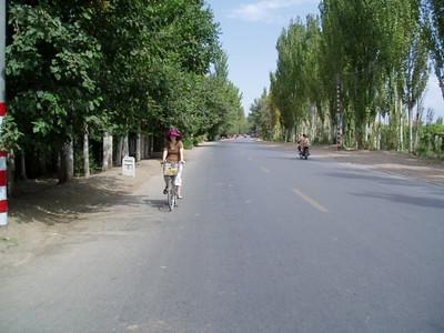 kiki riding the streets of turpan
