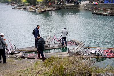 Bicycles and people are ferried across the river for a small fee in Yangshuo, China.