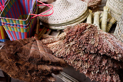 Brooms and hats for the locals, Fuli Market near Yangshuo, China.