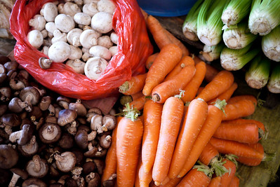 Bagged mushrooms and carrots at the vegetable section of the Fuli Market near Yangshuo, China.
