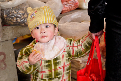 A very curious little one at the Fuli Market near Yangshuo, China.