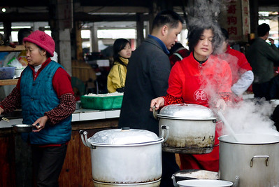 A local is prepping food at the Fuli Market near Yangshuo, China.
