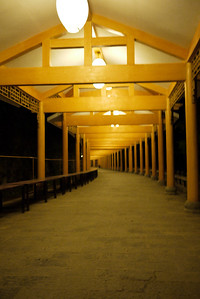 A long yellow walkway lights to the hostel in Yangshuo, China.