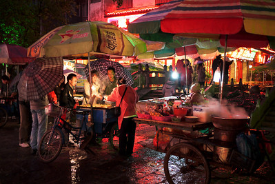A collection of street food stalls in Yangshuo, China.