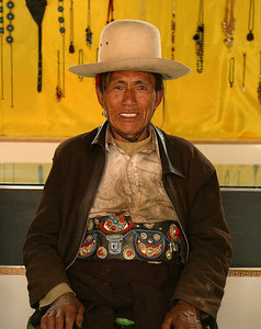 Met this very groovy guy on our LENGTHY road trip to Dechen. Here he is displaying his 'antique' money belts for sale.
