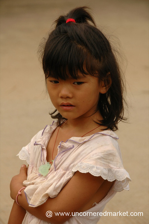 Chinese Girl Deep in Thought - Xishuangbanna, China