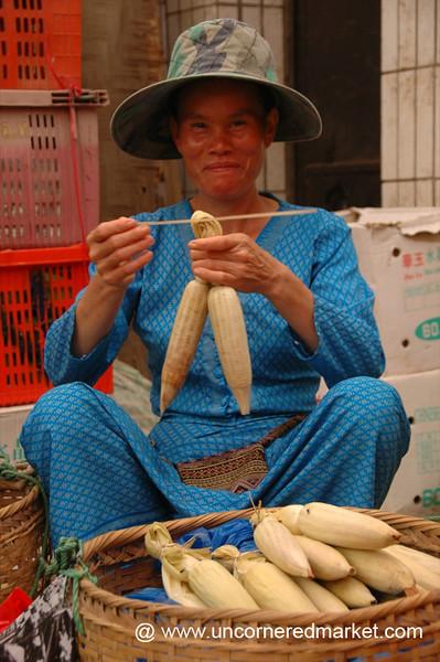 Vendor Tying Corns - Xishuangbanna, China