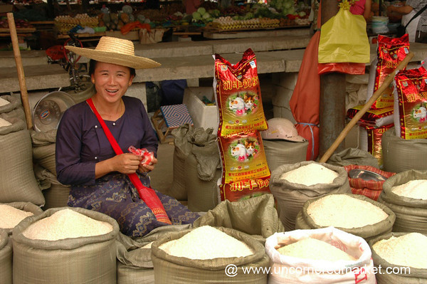 Smiling Dai Rice Vendor - Xishuangbanna, China